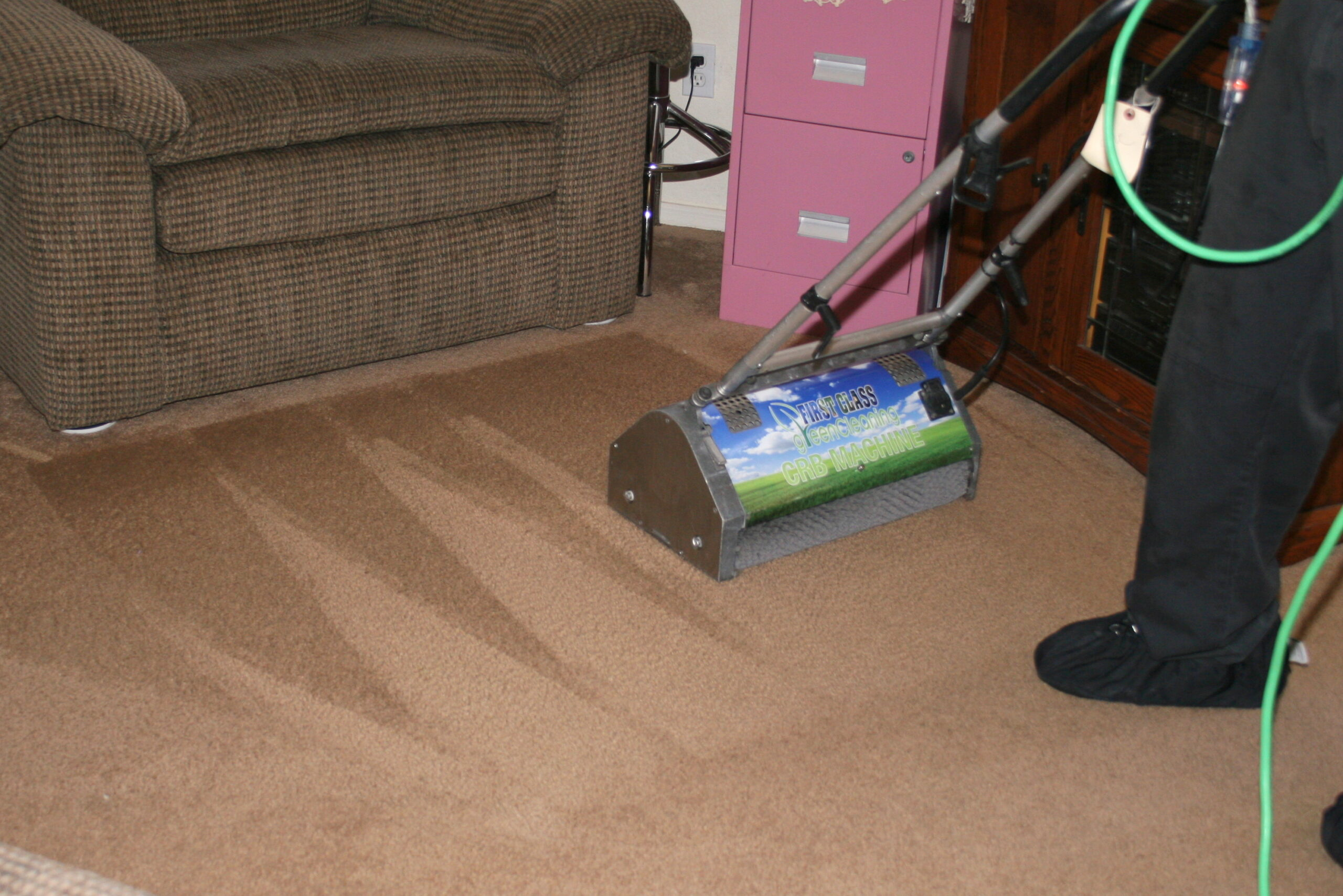 Residential and commercial interior cleaning in Phoenix by First Glass Green Cleaning showing carpet cleaning machine